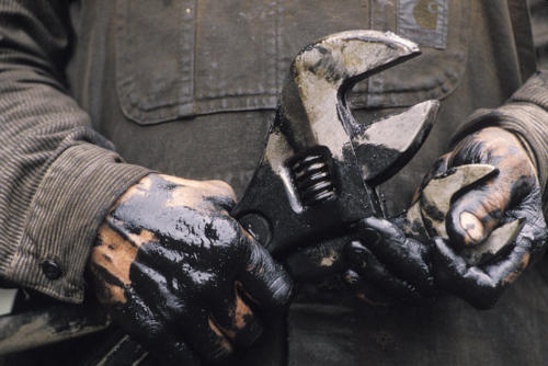 worker with oily hands